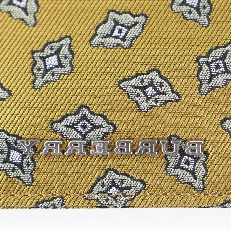 NEW $250 Gold Tucker Print Pouch
